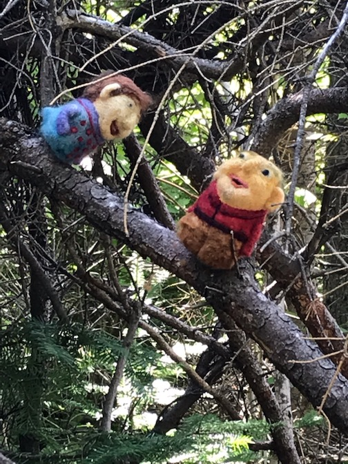 These happy felted beings are perched on a tree in the Felted Forest. They are crafted by Marlys Johnson.