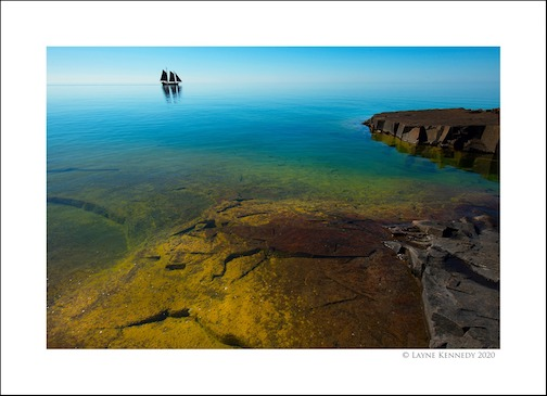 Gin-clear waters, by Layne Kennedy. He writes: This last Friday in Grand Marais, Minnesota, Lake Superior, the largest of the Great Lakes in North America, was like glass. Very rare for this big pond to lay down like this. With it's gin clear waters and brilliant colors, it felt like we were in the Caribbean at times.