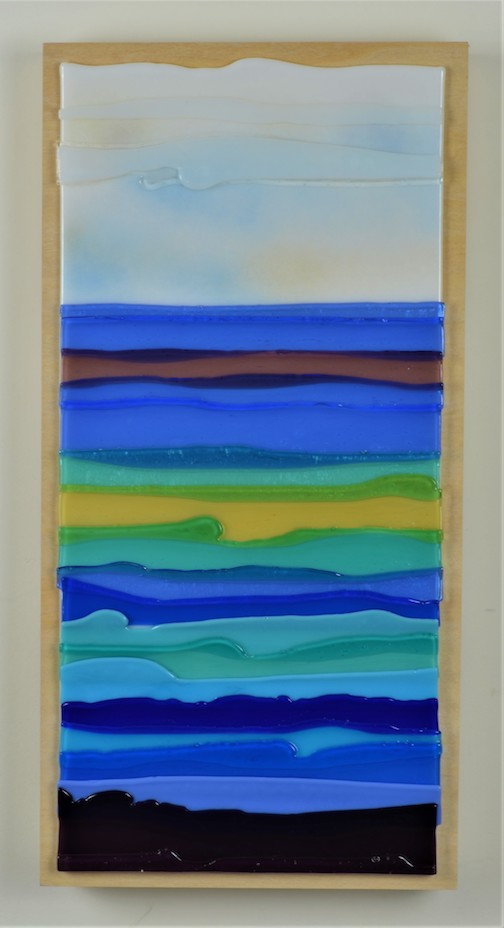"Fused glass artist Nancy Seaton has been working in her studio this summer, in preparation for the Fall Studio Tour in September. This piece is called ""Lake Superior."""