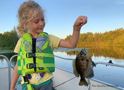 Silje with her sunfish by Paul Sundberg.