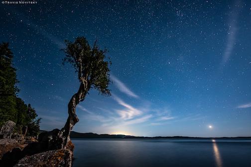 Venus rising over Lake Superior at sunrise by Travis Novitsky.