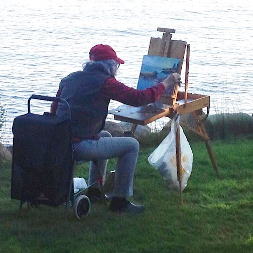 Plein air painter Kathy Weinberg works on a piece for Grand Marais Plein Air. Photo by John Weinberg.