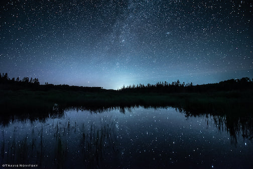 I love the nights when the air is so still that the stars reflect almost perfectly on the water. By Travis Novitsky.