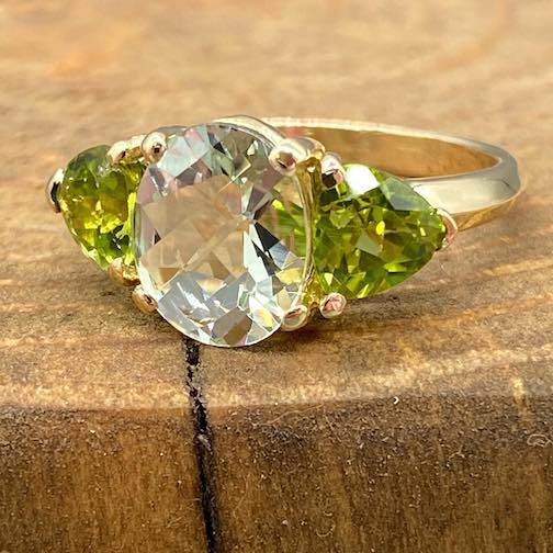 One of Steve Hahn's (Jeweler of the North) latest: Lime quartz center  framed by 2 trillion Peridots set in gold.