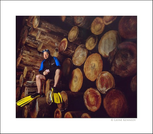 Expert diver Scott Mitchen with some of the logs he recovered from Lake Superior by Layne Kennedy.
