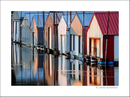 Boathouses in Red Wing by Layne Kennedy.