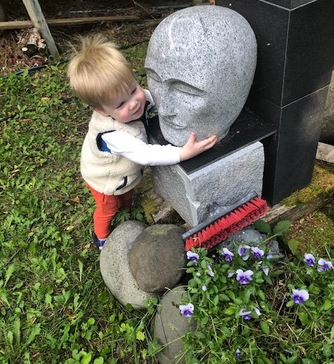This little boy has fallen in love with a sculpture by Dan Ross. It is at ground level and when the little boy discovered it, he fell in love. He even waves at it from the car when it passes by.
