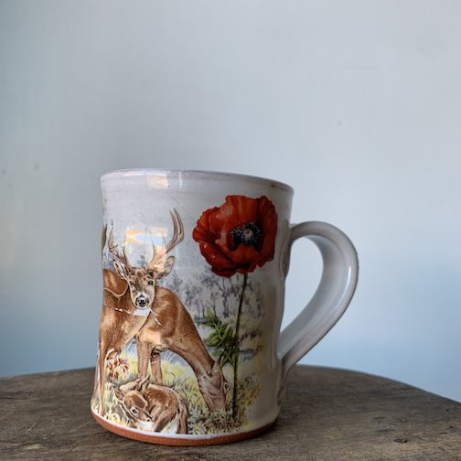 Justin Roth's descaled earthenware mug, Owl and Deer, can be found at Upstate Mn.