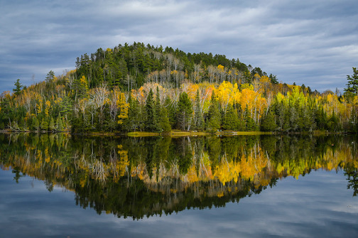 Fall reflections by Dennis Chick.
