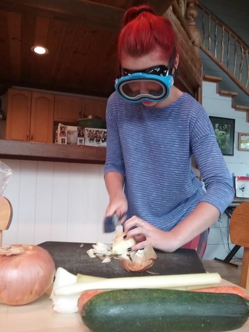 Dicing onions for culinary arts class by Krishna Woerheide.