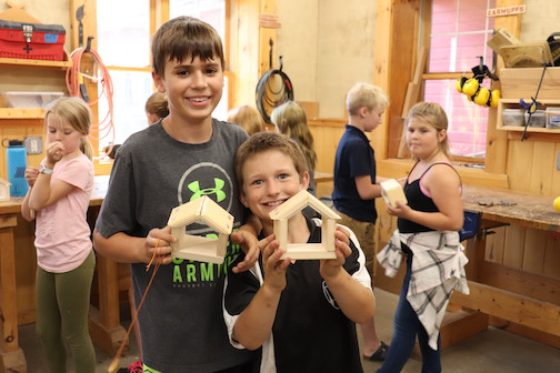 North House Folk School will offer classes for families, including woodworking projects, Luke making a birdhouse.