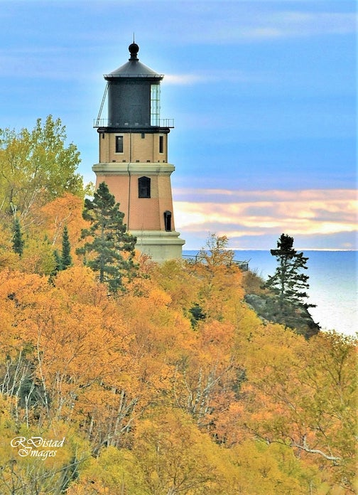 Split Rock Lighthouse draped in autumn colors by Roxanne Distad.