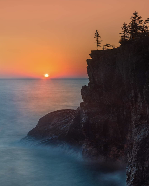 Sunrise and cliffs by Ken Harmon.