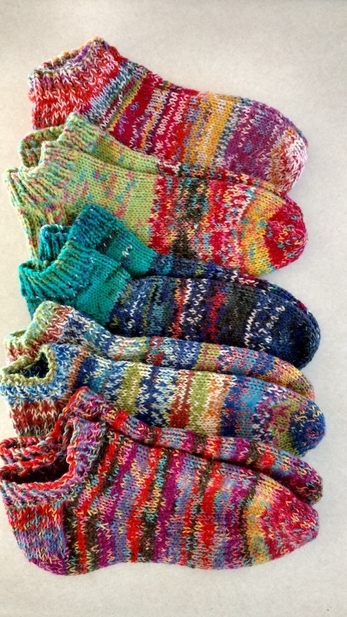 Paula Sundet Wolf has been using her remnant sock yarn  to make these beauties.