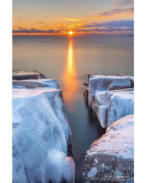 Sunrise and an icy crevice by Ken Harmon.