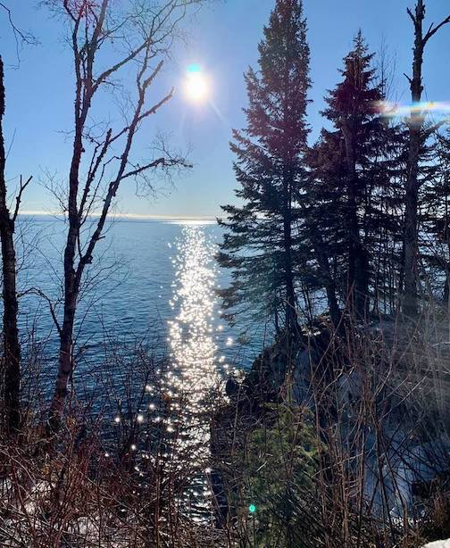 The sun on the Big Lake by Holly Lamond.