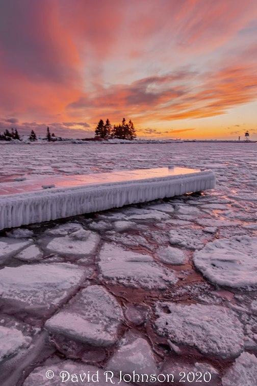 Pancake ice at dawn by David Johnson.
