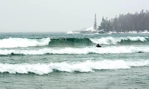Surfing Lake Superior by Lisa A Jacquares.