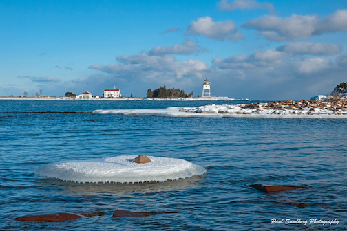 Icy rock in the harbor by Paul Sundberg.