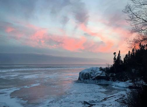 Sunset over ice by Roxann Berglund.