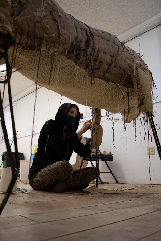 Corrie Steckelberg/Wulfhelm works on one of her caribou sculptures.