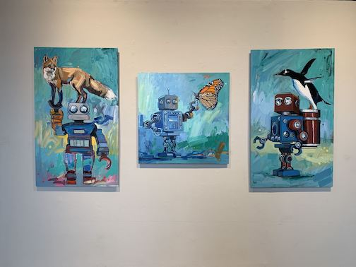 """Adam Swanson in one of the artists currently exhibiting at the Duluth Art Institute. Pictured, from left is """"Voice,"""" """"Carry the Weight"""" and """"My Bones May Break."""""""