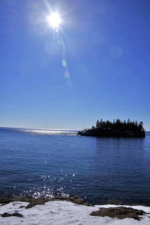Soaking in the sun on a beautiful day on Lake Superior by Kevin Severson.