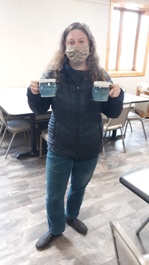 Ceramic artist Melissa Wickwire made Hug Mugs to be delivered with Meals on Wheels. Read why, below.