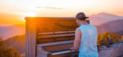 A piano at sunrise. Photograph illustrating the article on the benefits of playing music.