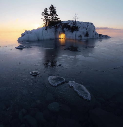 Sunrise through Hollow Rock by Person Buechler.