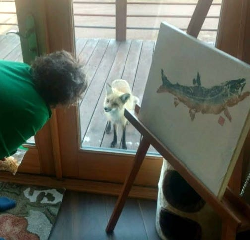 """""""We have the best conversations."""" Photo of Donna Lunke and their neighborhood fox by Orvis Lunke. Note: The Gyotaku fish print at right is by Cameron Norman, who created it from a fish Donna caught on Greenwood Lake."""