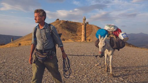 Walking the World. Paul Salopek explores ancient ruins in Saudi Arabia on his journey to walk the world. Photo by John Stanmeyer.