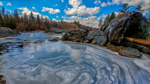 There's something about blue skies reflecting in swirling river foam ... by Mary Amerman.