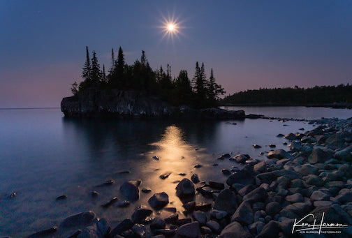 Moon, star and shimmer on the Lake Superior tombolo by Ken Harmon.