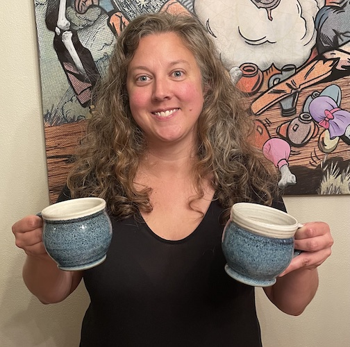 Melissa Wickwire holds examples of the Mug Hugs she made for members of the community, during the pandemic.