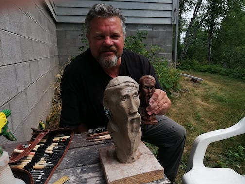 Tor Torkildson with his sculpture of Lao Tzu, one of the pieces that will be installed on a hiking trail, Inspiration Station Trail.