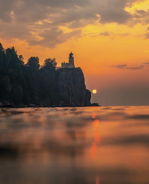 A smokey sunrise over Lake Superior by Christian Dalbec.
