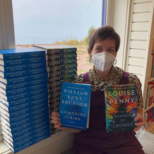 Gwen Danfelt of Drury Lane Books shows two new books by popular authors William Kent Krueger and Louise Penny.