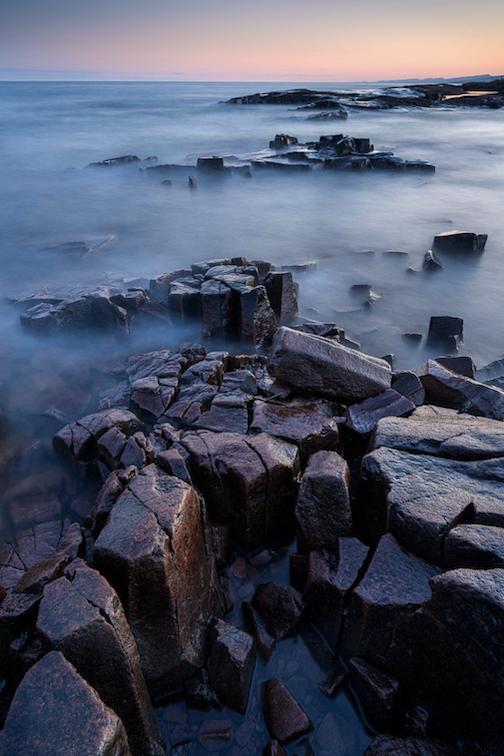 Breakwater basalt at sunset by Bryan Hansel.