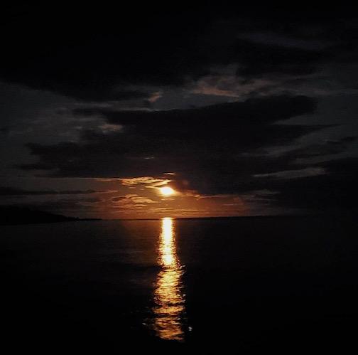 Almost full moon by Jamie Rex.