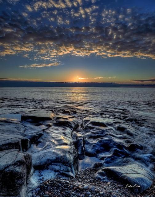 September sunrise on the stones by John Heino.