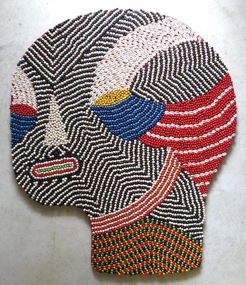 Brazilian-Mexican artist Fefe Talavera strings together elaborate masks that fuse ancient mythologies and contemporary urban culture. See more of her masks and read about her work here.
