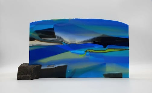 Through the Narrows, fused glass, by Nancy Seaton. Seaton's studio is at Hungry Jack Outfitters on the Gunflint Trail. Her husband, Dave Seaton, is a luthier, and is exhibiting his guitars at the site as well