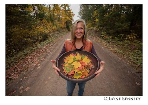 Diane Knutson with a tray of leaves by Layne Kennedy.