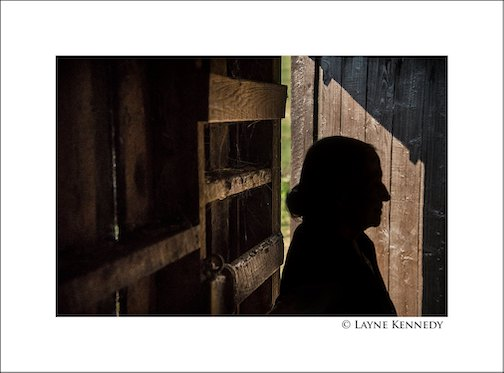 The incomparable Philis Anderson in her horse barn, Grand Marais, by Layne Kennedy.