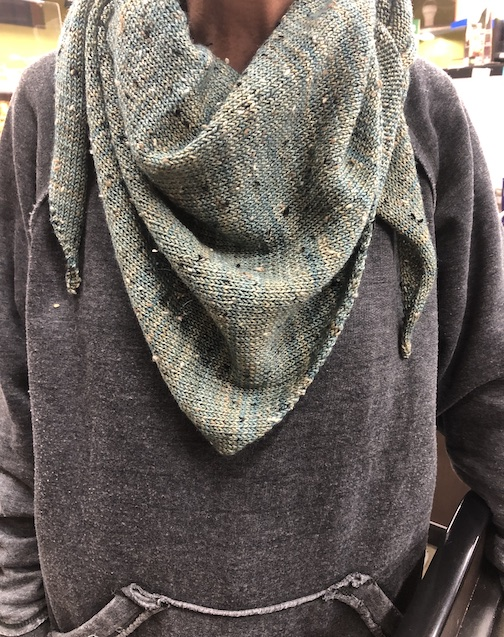 Mary Iuldahl models her scarf, Artist's Point. She created the pattern and knitted the piece. The pattern and the wool is available at Dappled Fern Fibers in Grand Marais.