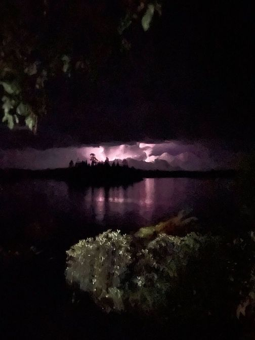 Lightning storm over the lake by Jeannine Oulette..